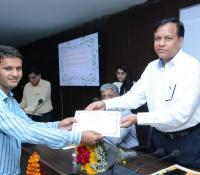 Director General, Defense Estates distributing citation and cash prizes to successful contestants