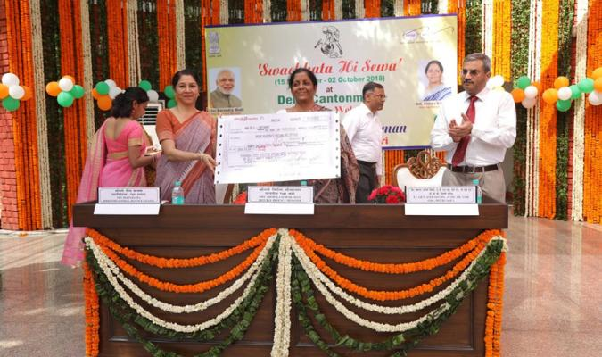 Swachhata Hi Seva, 2018: Smt Nirmala Sitharaman, Hon'ble RM receiving donation cheque from Smt Deepa Bajwa, DG DE for Kerala's Flood Disaster
